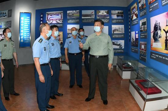 Chinese President Xi Jinping, also general secretary of the Communist Party of China (CPC) Central Committee and chairman of the Central Military Commission (CMC), visits the aviation museum of the Aviation University of the Air Force in northeast China's Jilin Province, July 23, 2020. Xi inspected the Aviation University of the Air Force in Jilin on Thursday, in the run-up to China's Army Day. On behalf of the CPC Central Committee and the CMC, Xi extended Army Day greetings to the personnel of the People's Liberation Army (PLA), the Armed Police Force, the militia, and the reserve force. China's Army Day falls on Aug. 1. (Xinhua/Li Gang)